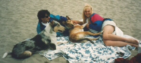 Kallie and her foster parents on the beach